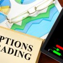 46156773 - words options trading written on a book. business concept.